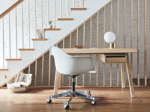 A residential work setting featuring an Eames Task Chair and Distil Desk.
