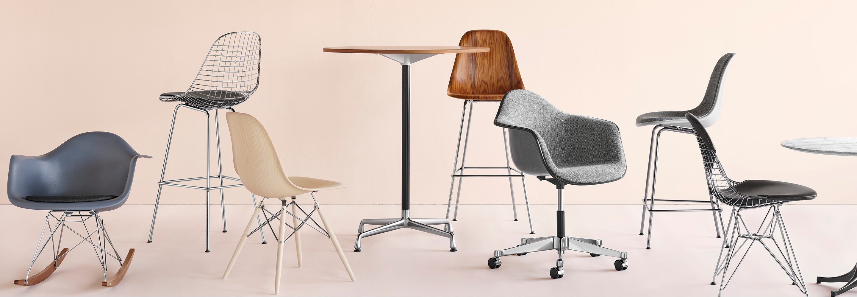A casual arrangement of Eames shell chairs and stools in fibreglass, wire, wood and plastic.