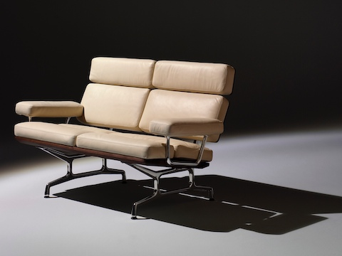 Ivory-colored Eames loveseat, viewed from a 45-degree angle.