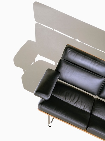 Overhead view of a partial black leather Eames Sofa.