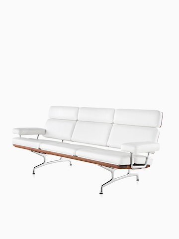 White Eames Sofa. Select to go to the Eames Sofa product page.
