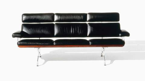 Black leather Eames Sofa, viewed from the front.