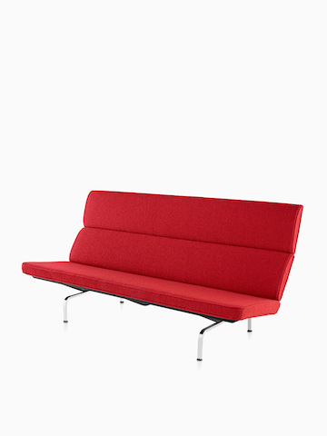Red Eames Sofa Compact. Select to go to the Eames Sofa Compact product page.