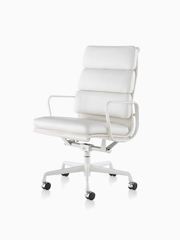 White leather Eames Soft Pad high-back executive chair, viewed from a 45-degree angle.