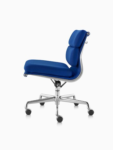 Profile view of a blue upholstered Eames Soft Pad Chair.