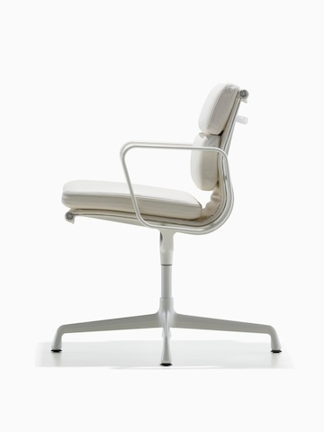 Profile view of a white leather Eames Soft Pad Chair.