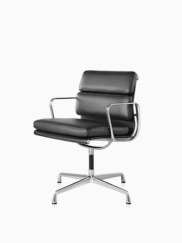 Black Eames Soft Pad Chair. Select to go to the Eames Soft Pad Chairs product page.
