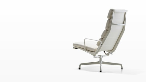 Three-quarter rear view of a white Eames Soft Pad lounge chair.