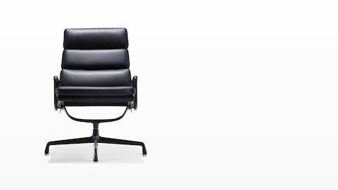 Black leather Eames Soft Pad lounge chair with a black frame and base, viewed from the front.