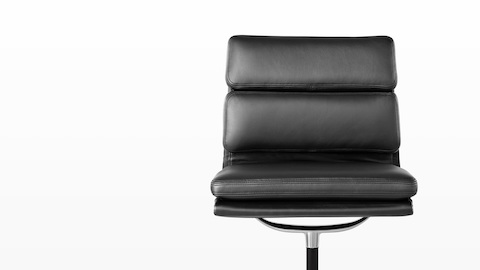 The plush seat and back cushions on a black leather Eames Soft Pad Chair, viewed from the front.