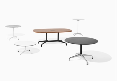 Five Eames Tables of various heights, top shapes, finishes, and base styles.