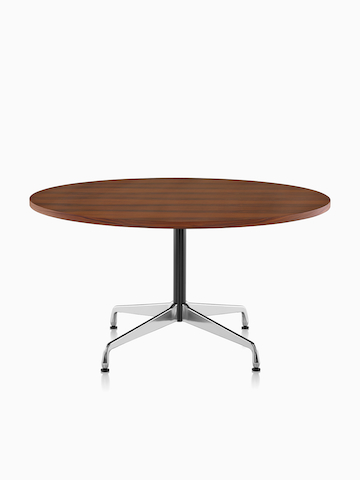 A round Eames Table with a dark veneer top.