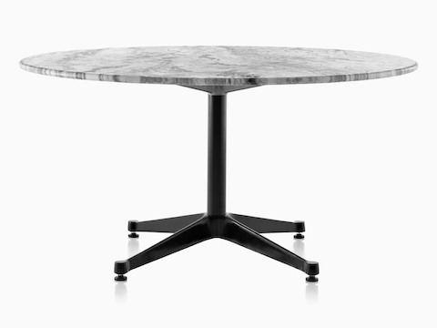 A round Eames outdoor table with a grey marble top and black base.
