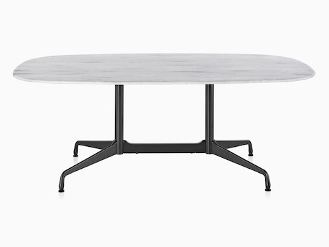 An Oval Eames Outdoor Table With A White Marble Top And Black Base