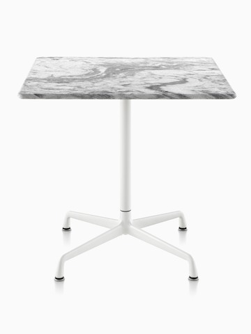 A square Eames outdoor table with a grey marble top and white base.