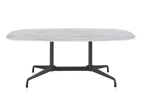 An oval Eames outdoor table with a white marble top and black base.