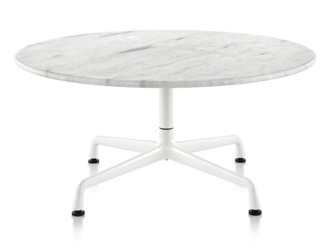 A round Eames outdoor table with a white marble top and white base.