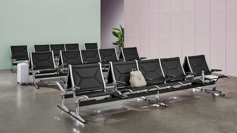 Multiple rows of Eames Tandem Sling Seating in a public waiting area.