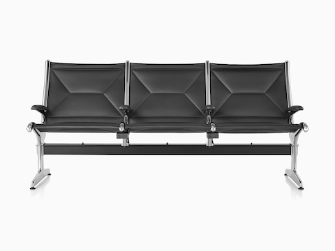 Black Eames Tandem Sling Seating with three seating positions and built-in charging modules, viewed from the front.