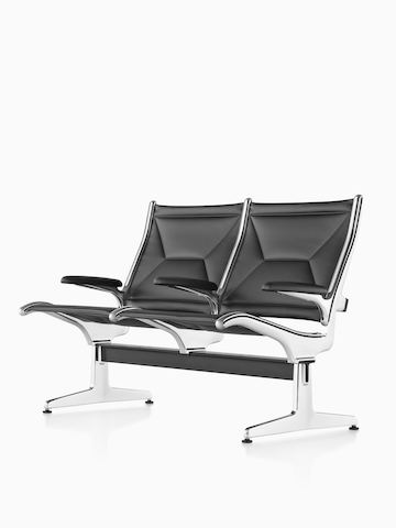 Black Eames Tandem Sling Seating. Select to go to the Eames Tandem Sling Seating product page.