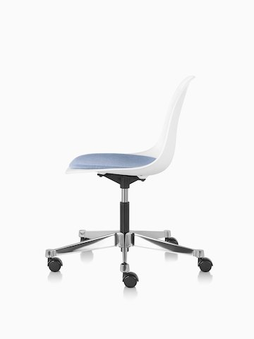 Side view of Eames Task Chair with blue upholstered seat pad and white plastic shell.