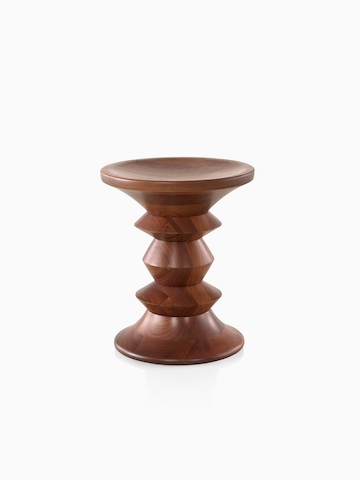 An Eames Walnut Stool, showing one of the three distinct profiles.