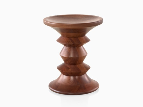 A solid wood Eames Walnut Stool.
