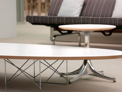 Close view of the wire-rod base on a white Eames Wire Base Elliptical Table.