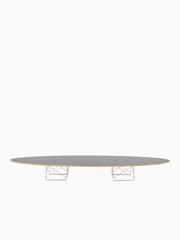 An Eames Wire Base Elliptical Table with a gray top.