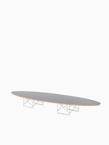 An Eames Wire Base Elliptical Table with a gray top. Select to go to the Eames Wire Base Elliptical Table product page.