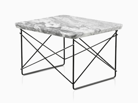 An angled view of an Eames Wire Base Low Table with a stone top.