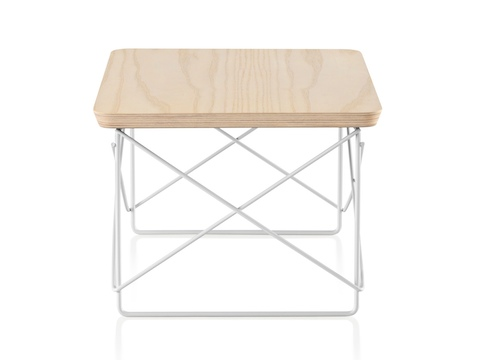 An Eames Wire Base Low Table with a white ash veneer top.