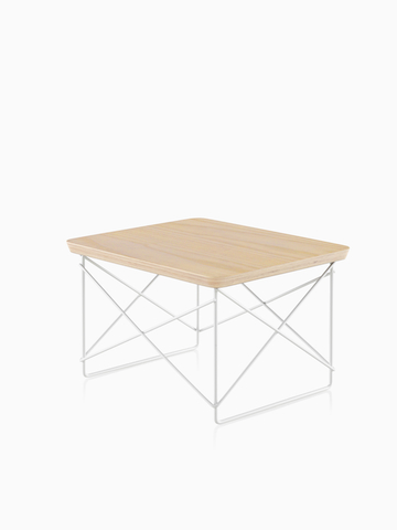 A rectangular Eames Wire Base Low Table with a light wood finish. Select to go to the Eames Wire Base Low Table product page.