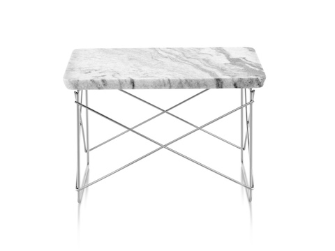 A rectangular Eames Wire Base Low outdoor table, showing the two-centimeter-thick marble top with a beveled edge.