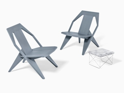Charmant An Eames Wire Base Low Outdoor Table With Two Gray Outdoor Chairs.