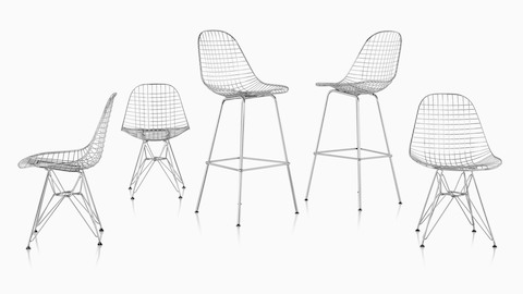 Two Eames Wire Stools and three Eames Wire Chairs with wire bases.