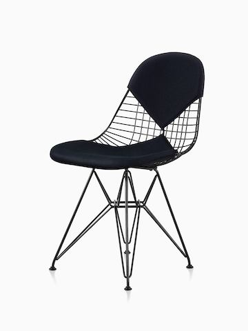 A black Eames Wire Chair with a bikini seat and back. The chair features a black wire base. Viewed at an angle.
