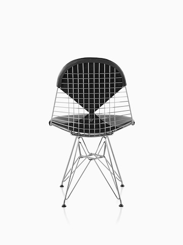 Rear view of an Eames Wire side chair with a wire base and a black two-piece pad reminiscent of a bikini.