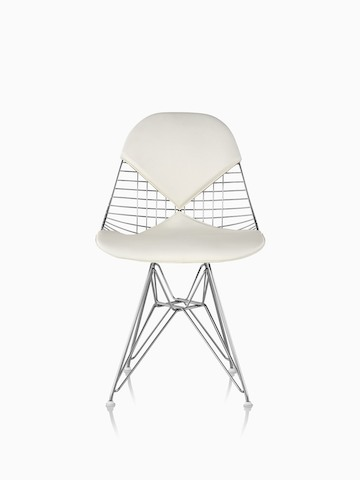 Front view of an Eames Wire side chair with a wire base and a white two-piece pad reminiscent of a bikini.