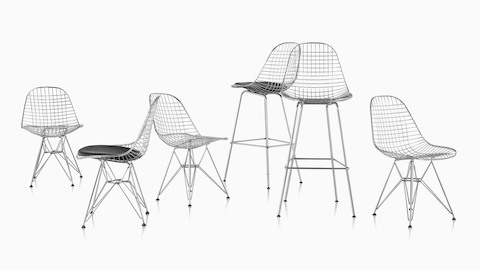 Two Eames Wire stools and four Eames Wire chairs with a mix of seat options.