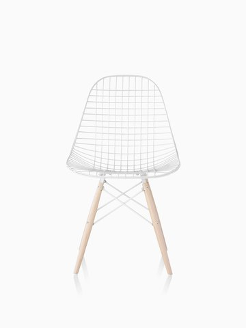White Eames Wire Chair with light wood dowel base.