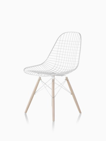 White Eames Wire Chair with light wood dowel base. Select to go to the Eames Wire Chairs product page.