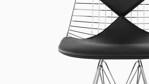 Close-up of the optional two-piece, bikini-style seat pad on an Eames Wire side chair.