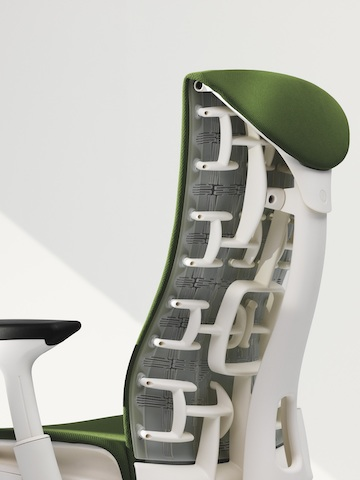 Three-quarter rear view of a green Embody office chair, showing back support.