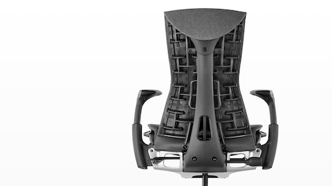 Rear view of a black Embody office chair, showing back support.