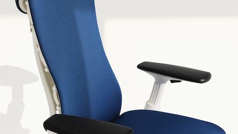 Arm-height control on an Embody Chair  with blue upholstery and a white frame.