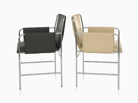 Side view of two Envelope Chairs back-to-back, one with black upholstery and one with tan upholstery.