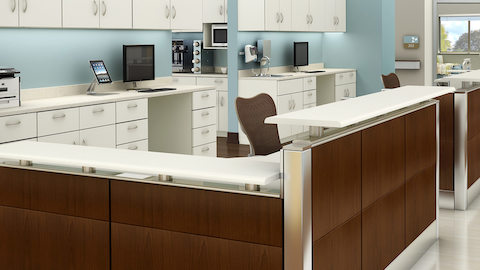 Two healthcare workstations configured from Ethospace Nurses Station storage and surface elements.