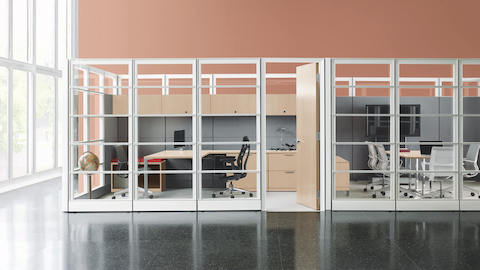 Private office created from Ethospace System panels with Black Embody ergonomic desk chair next to a private conference room with Setu office chairs.