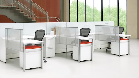 Ethospace workstations with fabric screens and black Aeron ergonomic desk chairs.